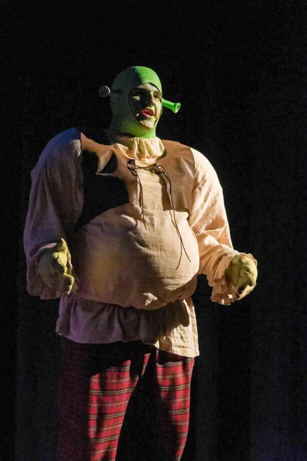 "STEVEN SIMPKINS | for the Daily News Fletcher Nowak rehearses a scene from Midland High's performance of ""Shrek: The Musical"" at Bullock Creek High School Tuesday afternoon. The show opens Thursday at 7 p.m. and will run Friday and Saturday as well. Photo: Steven Simpkins/Midland Daily News"