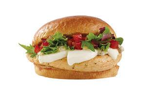 Wendy'sFresh Mozzarella Chicken Sandwich is served on a brioche bun.