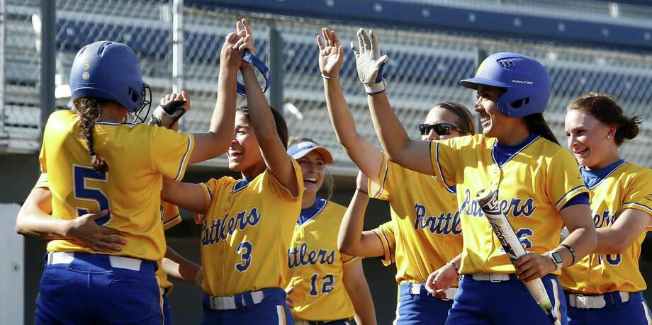 St. Mary's Rattlers, including Kristal Salinas (3) and Raynelle Nash (5), celebrate after Marcela Vasquez knocked in the winning run against Rogers State. Photo: Ron Cortes /For The Express-News / Freelance