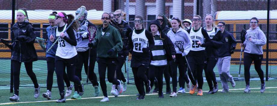 The New Milford High School girls' varsity lacrosse warm up before their April 1 seasoner opener against Granby Memorial High School. Photo: Courtesy Of Katie Alzapiedi / The News-Times Contributed