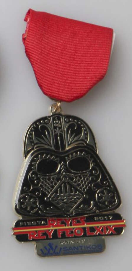"Rey Feo Fred Reyes' ""Star Wars"" Fiesta medals are a force to be reckoned with this year. Sponsored by Santikos Entertainment, Reyes' medals consist of Darth Vader. Photo: Juanito M Garza / San Antonio Express-News"