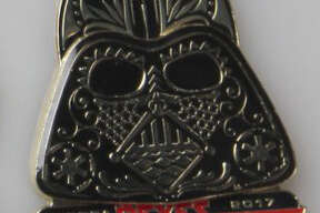 """Rey Feo Fred Reyes' """"Star Wars"""" Fiesta medals are a force to be reckoned with this year. Sponsored by Santikos Entertainment, Reyes' medals consist of Darth Vader."""