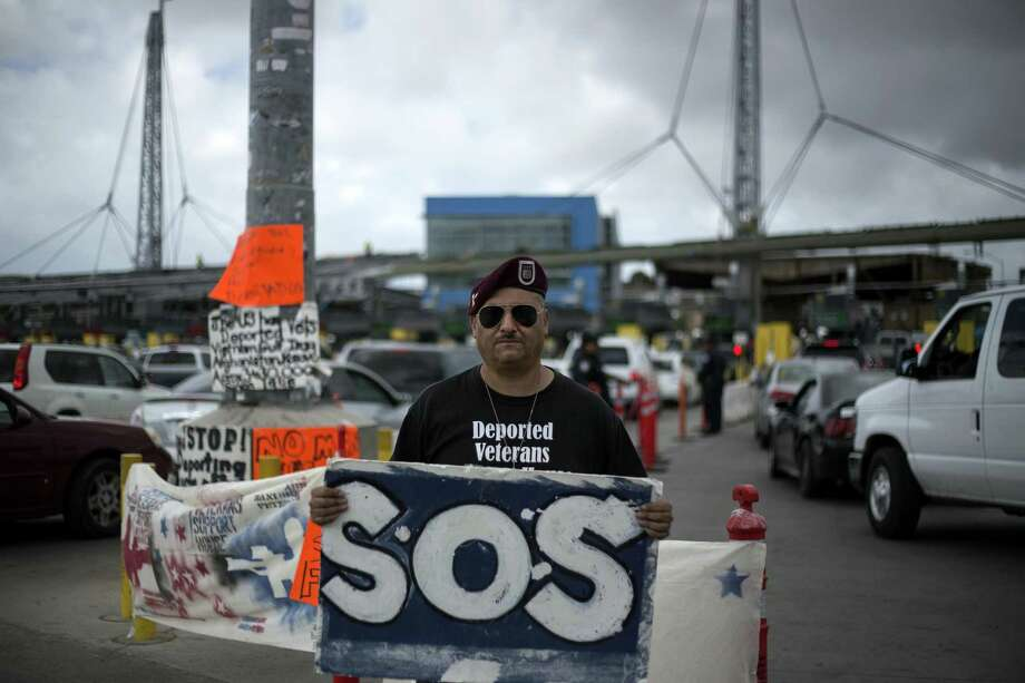 The deported veteran Hector Barajas Varela, 36, takes part during a demonstration with members of the organizations Veterans Without Borders, Banished Veterans and the International Humanitarian Promigrant Rights Coalition on March 27, 2017 at the San Ysidro Gate, in Tijuana, northwest Mexico. (Guillermo Arias/Xinhua/Sipa USA/TNS) Photo: Xinhua, MBR / TNS / Sipa USA