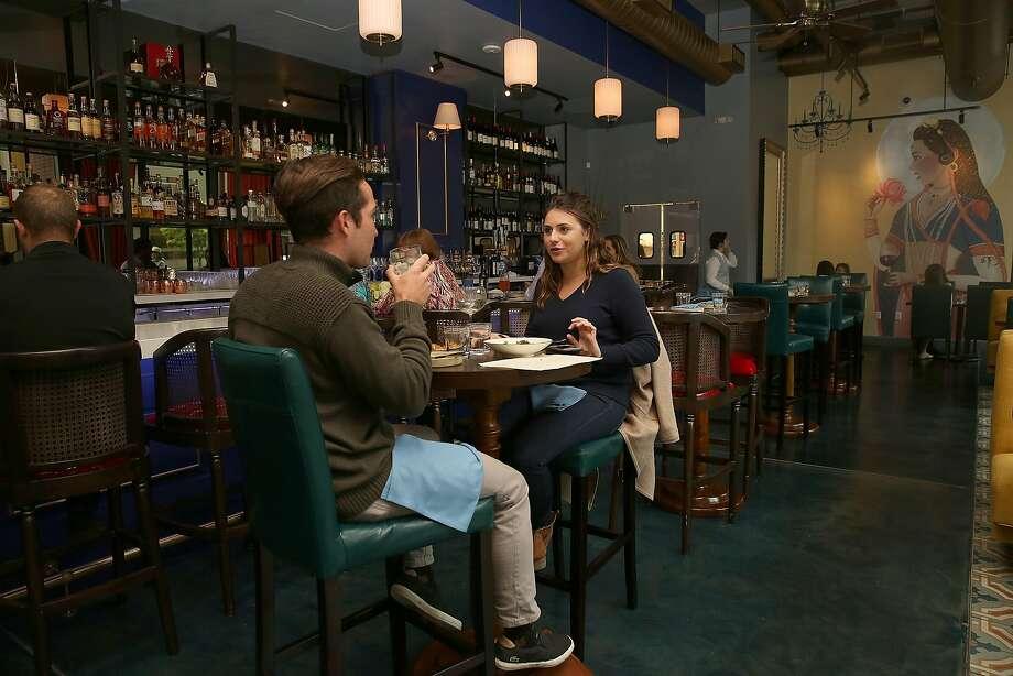 Michael Gorecki (left) and Christy Ottesen have dinner at Rooh. Photo: Liz Hafalia, The Chronicle