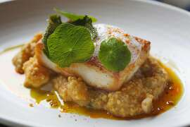 Local halibut with gun powder spice, seafood and millet khichdi, and lemon foam served at Rooh on Tuesday, April 18, 2017, in San Francisco, Calif.