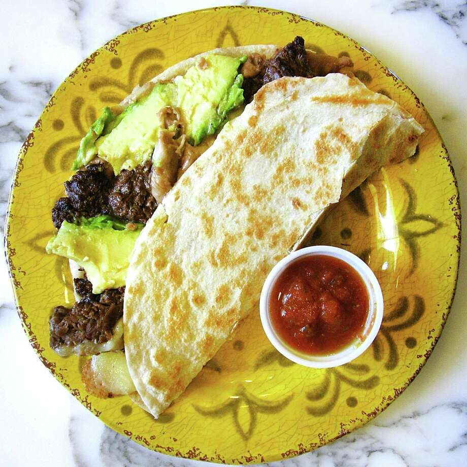 The Super Taco with beef fajitas, beans, cheese and avocado on a handmade flour tortilla from Sandra's Mexican Food on SW Loop 1604. Photo: Mike Sutter /San Antonio Express-News
