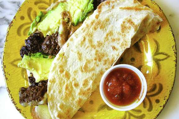The Super Taco with beef fajitas, beans, cheese and avocado on a handmade flour tortilla from Sandra's Mexican Food on SW Loop 1604.