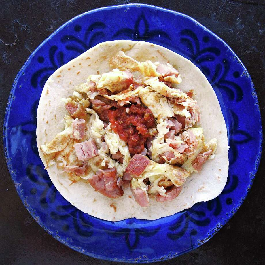 Spam and eggs taco on a handmade flour tortilla from Dos Jalisco Mexican Restaurant. Photo: Mike Sutter /San Antonio Express-News