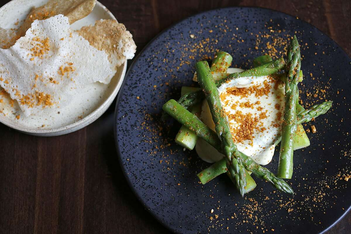 Asparagus pepper fry with podi masala, curried cauliflower mousse and dosa crisp served at Rooh on Tuesday, April 18, 2017, in San Francisco, Calif.