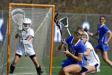 Darien's Christine Fiore looks to make a turn with the ball during a game against Staples Thursday.