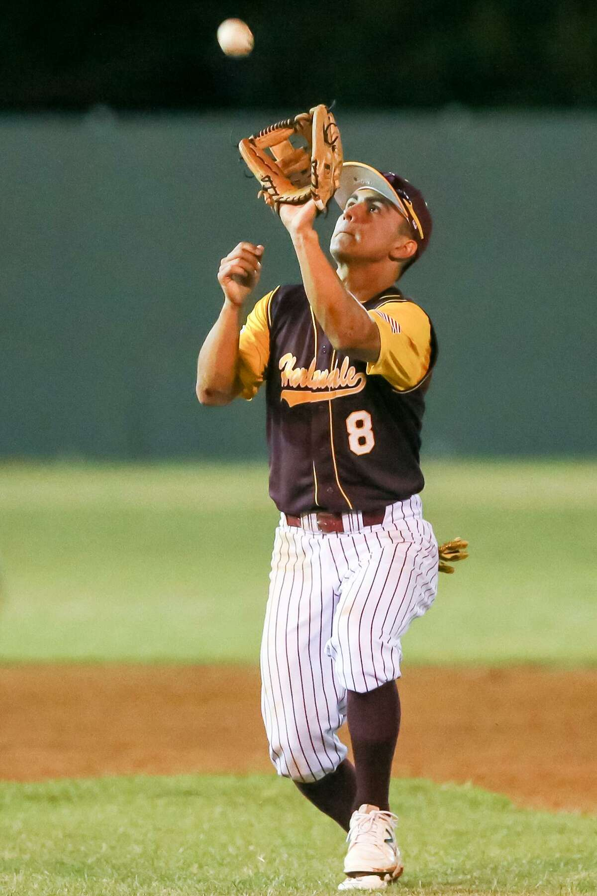 Harlandale's Shawn Tober catches a pop up in District 28-5A action against McCollum in April.