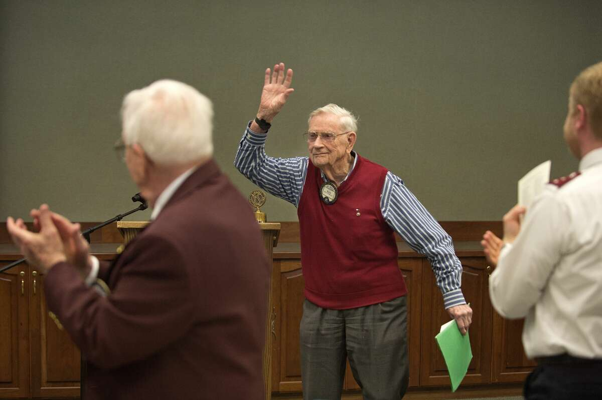 """BRITTNEY LOHMILLER   blohmiller@mdn.net Kiwassee Kiwanis of Midland charter member Max Bottomley waves to attendees during the 50th anniversary of the beginning of the club at Trinity Lutheran Church Tuesday afternoon. """"I just wanted to say, ladies and gentlemen, it's been a pleasure to be a part of Kiwanis,"""" Bottomley said. Bottomley and Allen Ott are the last two remaining charter members of the Kiwassee Kiwanis, which was started in 1967."""