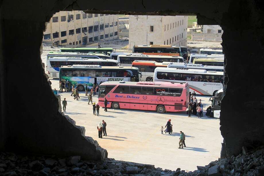 Syrians from the towns of Fuaa and Kafraya, which have been under crippling siege for more than two years, arrive in the government-held city of Aleppo. Photo: OMAR HAJ KADOUR, AFP/Getty Images