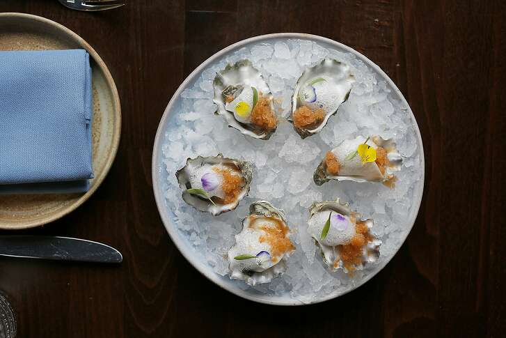 Fresh oyster with pink guava and chili granita, lemon foam and pickled turnip served at Rooh on Tuesday, April 18, 2017, in San Francisco, Calif.