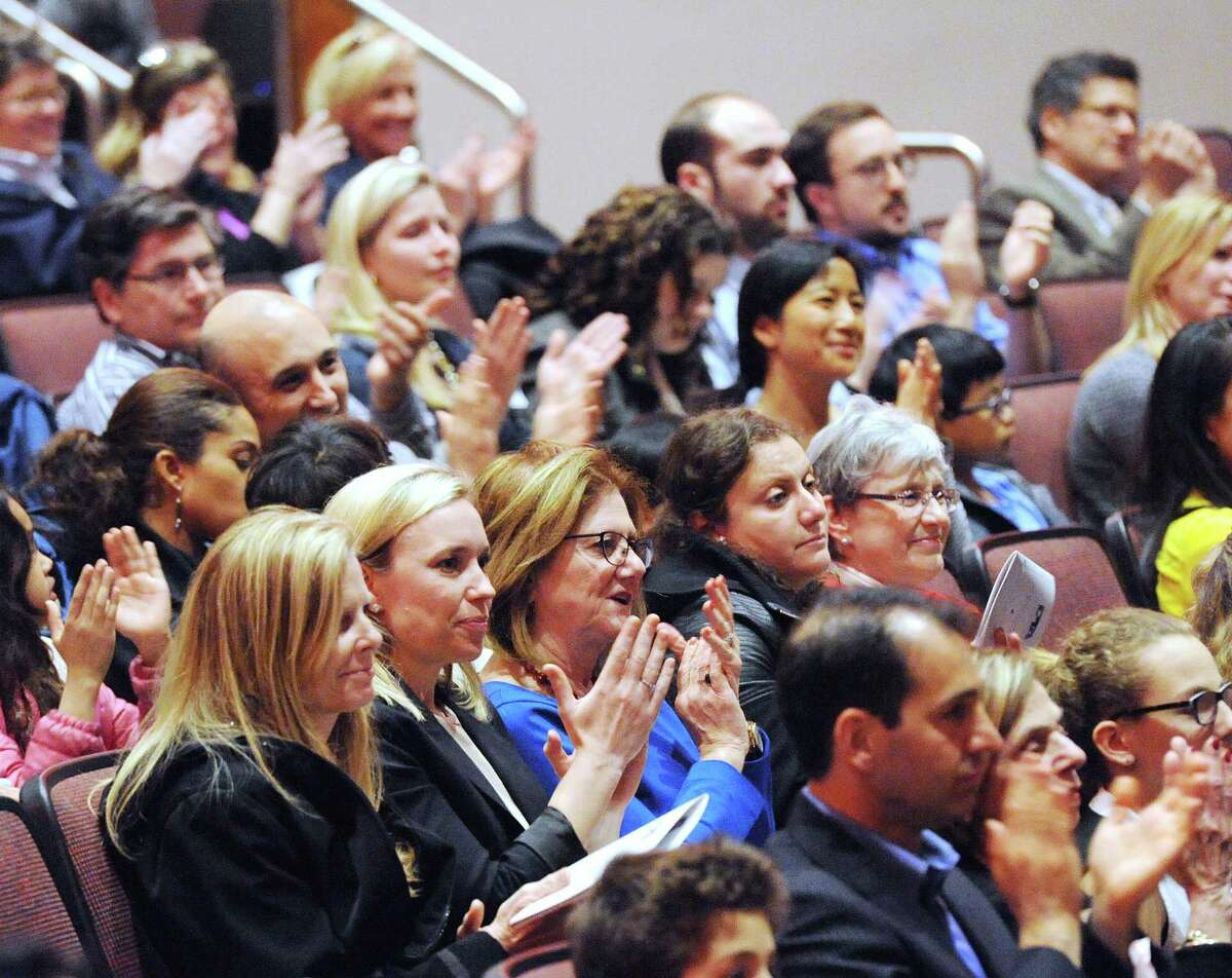 The audience applauds during last year's Greenwich Public Schools Distinguished Teachers Awards Ceremony at the Greenwich High School Performing Arts Center, Conn., Tuesday, May 3, 2016.