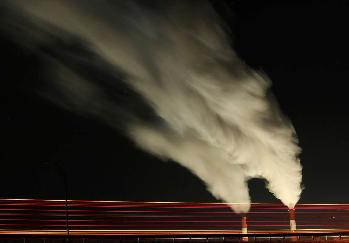 FILE - In this Jan. 19, 2012 file photo, smoke rises in this time exposure image from the stacks of the La Cygne Generating Station coal-fired power plant in La Cygne, Kan. The Environmental Protection Agency on Tuesday, April 18, 2017, asked a federal appeals court in Washington to postpone consideration of 2012 rules requiring energy companies to cut emissions of toxic chemicals. The agency said in a court filing it wants to review the restrictions, which were set to kick in next month. (AP Photo/Charlie Riedel, File)