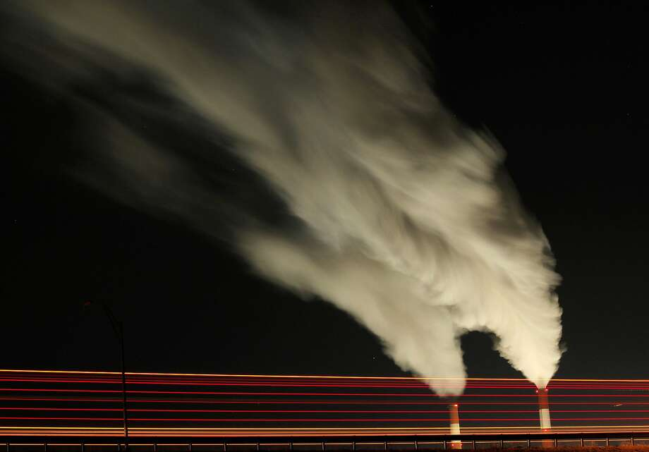 FILE - In this Jan. 19, 2012 file photo, smoke rises in this time exposure image from the stacks of the La Cygne Generating Station coal-fired power plant in La Cygne, Kan. The Environmental Protection Agency on Tuesday, April 18, 2017, asked a federal appeals court in Washington to postpone consideration of 2012 rules requiring energy companies to cut emissions of toxic chemicals. The agency said in a court filing it wants to review the restrictions, which were set to kick in next month. (AP Photo/Charlie Riedel, File) Photo: Charlie Riedel, Associated Press