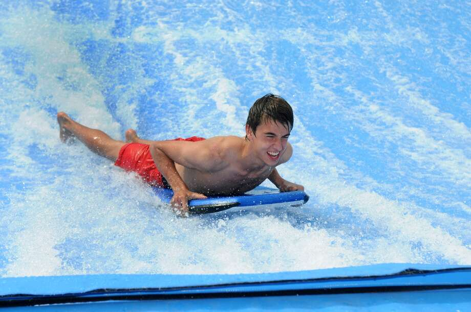 Noah Tobias, 15, of Tomball, rides the waves on the FlowRider, an innovative body boarding experience that rolls out waves at 35 mph, during it's debut at Wet'n'Wild SplashTown on May 2nd. Photo: Jerry Baker, Freelance