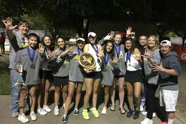 The St. Agnes tennis team won its fifth consecutive TAPPS state championship April 12-13 at Waco Regional Tennis Center. Pictured from left are Coach Tom Caine, Regina Lopez, Jordan Ham, Anika Yzaguirre, Kendal Couch, Christina Watson, Rachel Ham, Caitlin Boeker, Natalia Nassar, Coach Jeff Wheeler, Coach Kris Caine and Coach Tuyen Nguyen.