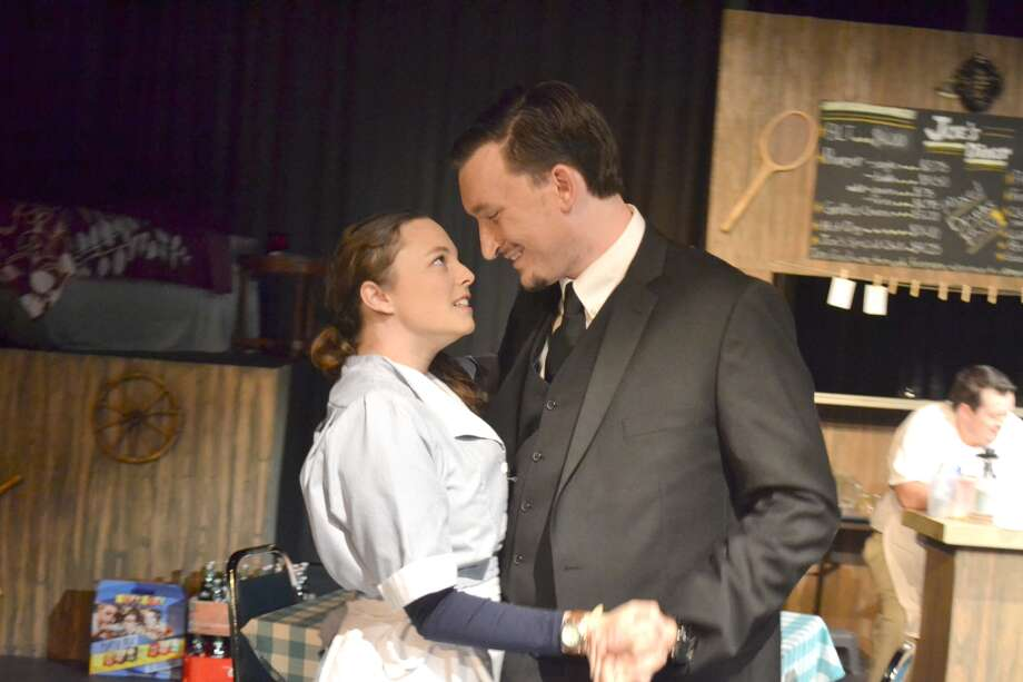 """Characters Maggie, played by Lillie Cooper, and Roger, played by Josh Walters, share a dance in the diner in """"Roach."""" Written by Wayland alum Rita Cox, """"Roach"""" will premiere Thursday through Saturday at 7:30 p.m. in the Black Box theater."""