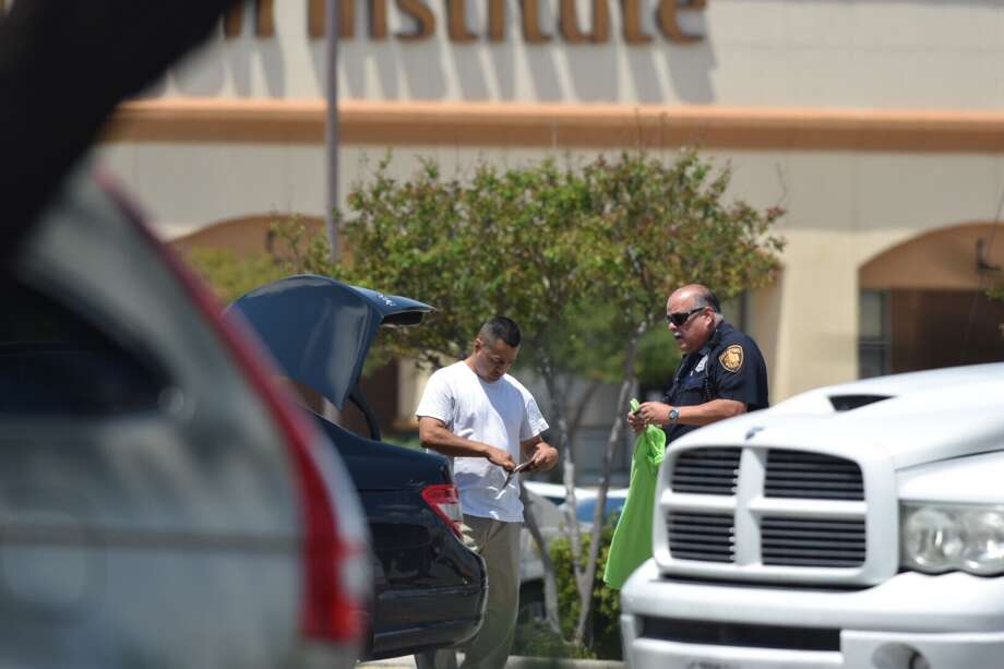 A man was slashed across the chest Wednesday, April 19, 2017, in the parking lot of a Northwest Side Jason's Deli after he got into an argument with another man, who police say could be an employee of the restaurant. Photo: Caleb Downs / San Antonio Express-News