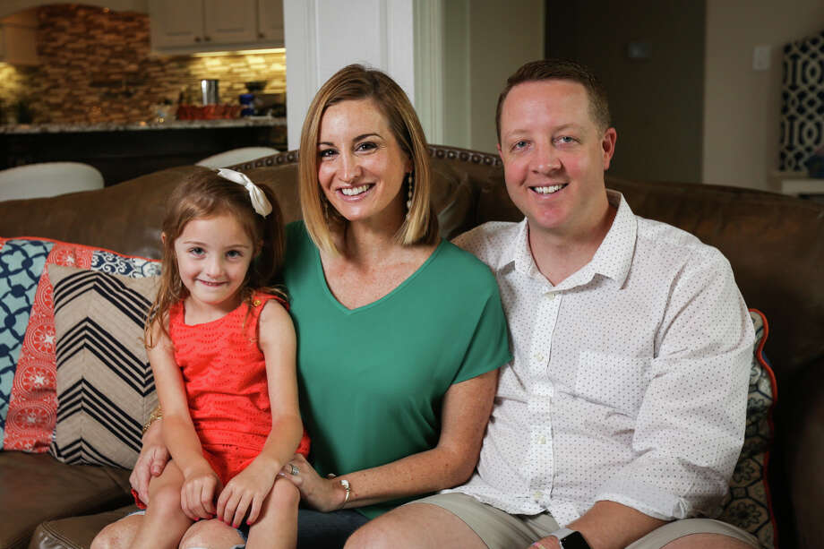 Andrew and Bria Huber and their 4-year-old daughter Kenley pose for a portrait on Monday at their home in The Woodlands. The Huber parents were wrongly accused of abusing their daughter Kenley when they took her to the hospital with broken bones in 2012. Later she was diagnosed with Ehlers-Danlos syndrome, a genetic connective tissue disorder. Photo: Michael Minasi, Staff Photographer / © 2017 Houston Chronicle
