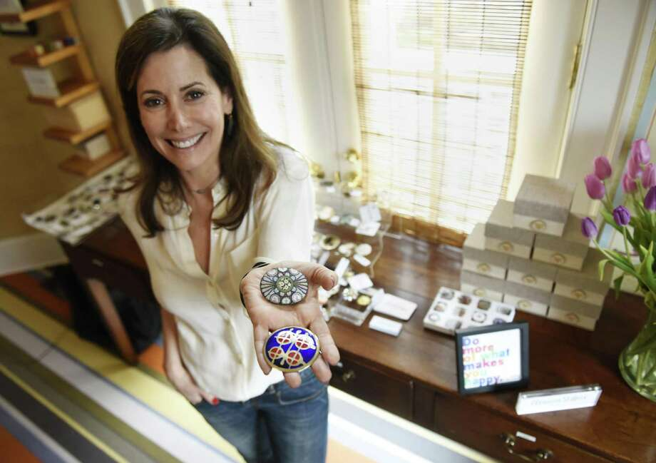 Nancy Cook shows pieces from her Eleanor Stone NYC jewelry collection at her home workspace in the Belle Haven section of Greenwich, Conn. Wednesday, April 12, 2017. Cook recently started her business in which she takes antique jewelry and re-purposes it on thick leather wrap cuffs. Photo: Tyler Sizemore / Hearst Connecticut Media / Greenwich Time