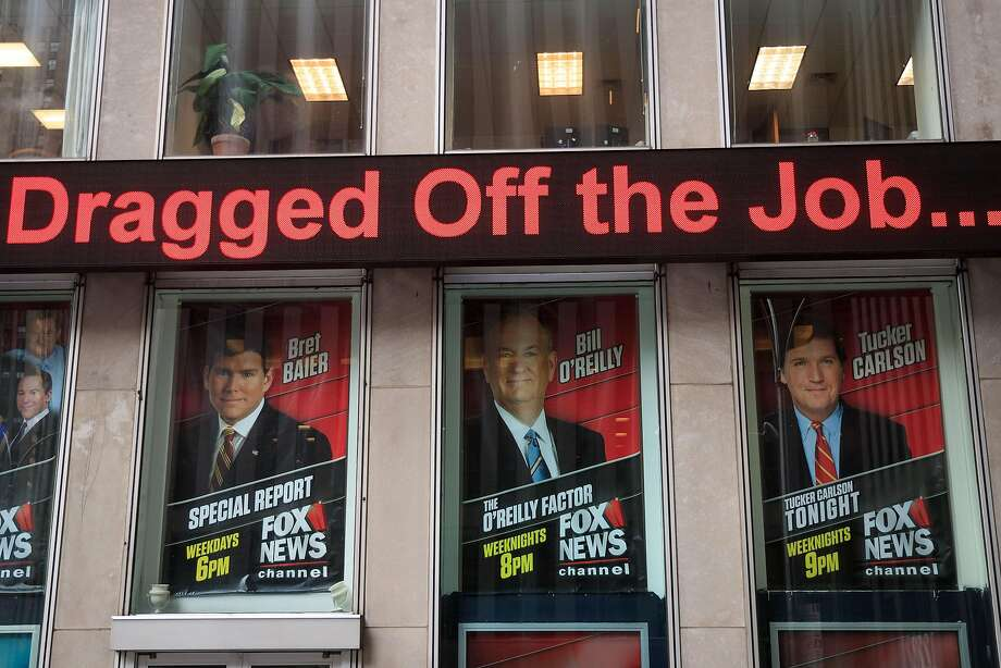 Advertisements for Fox News personalities, including Bill O'Reilly, stand in the windows outside of the News Corp. and Fox News headquarters in Midtown Manhattan. Photo: Drew Angerer, Getty Images