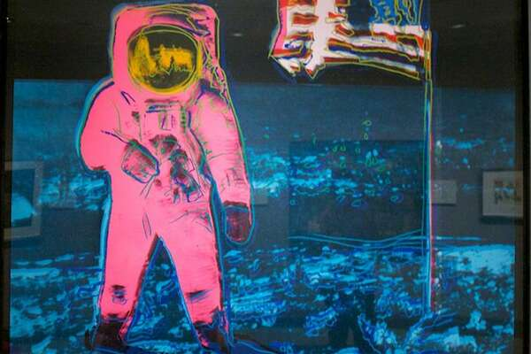 Description: The famous image of astronaut Buzz Aldrin standing on the Moon has become an icon of popular culture. The American hero with the U.S. flag became material for Warhol's silkscreen series of nationally known images printed on vibrant, retro, poster colors.