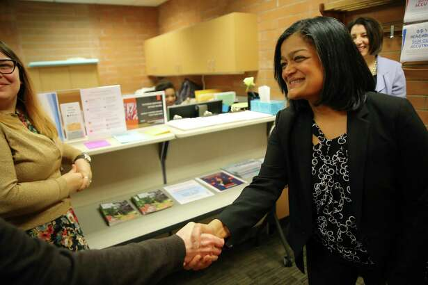 Representative Pramila Jayapal (D-WA, 7) shakes hands with Karin Heffel Steele during a tour of the library at Shoreline Community College ahead of a town hall meeting at the school, Tuesday, April 18, 2017.
