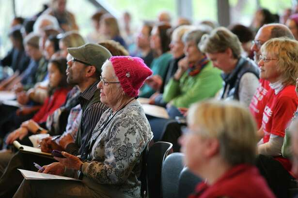 Constituents listen as Representative Pramila Jayapal (D-WA, 7) speaks during a town hall meeting at Shoreline Community College, Tuesday, April 18, 2017. She has held four town hall meetings in recent weeks.