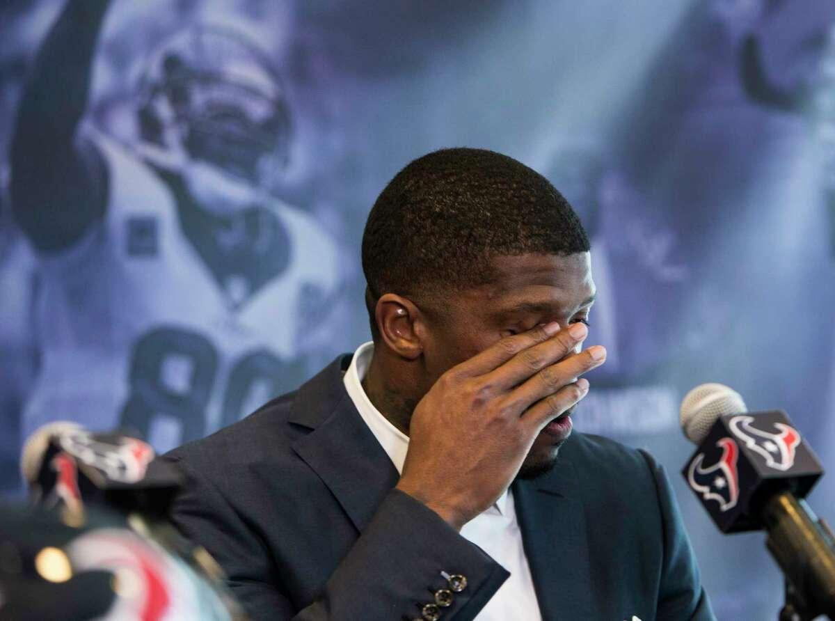 Former Houston Texans wide receiver Andre Johnson pauses to wipe his eyes as he speaks during a retirement ceremony at NRG Stadium on Wednesday, April 19, 2017, in Houston. Johnson signed a one-day contract to retire as a Texans player.