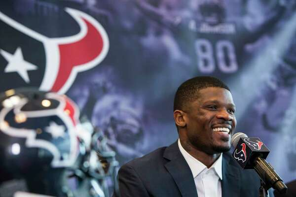 Former Houston Texans wide receiver Andre Johnson smiles as he speaks during a retirement ceremony at NRG Stadium on Wednesday, April 19, 2017, in Houston. Johnson signed a one-day contract to retire as a Texans player.