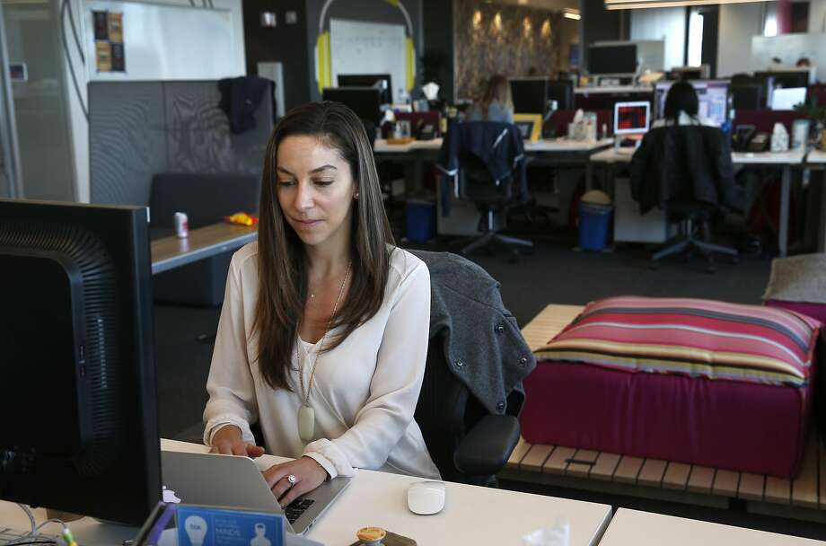 Victoria Makras works at her marketing department job at Box Inc. after commuting by Caltrain in Redwood City on Wednesday. Box is one of a few companies that has relocated to more transit-friendly environs and offers free Caltrain transit passes to its employees. Photo: Paul Chinn, The Chronicle
