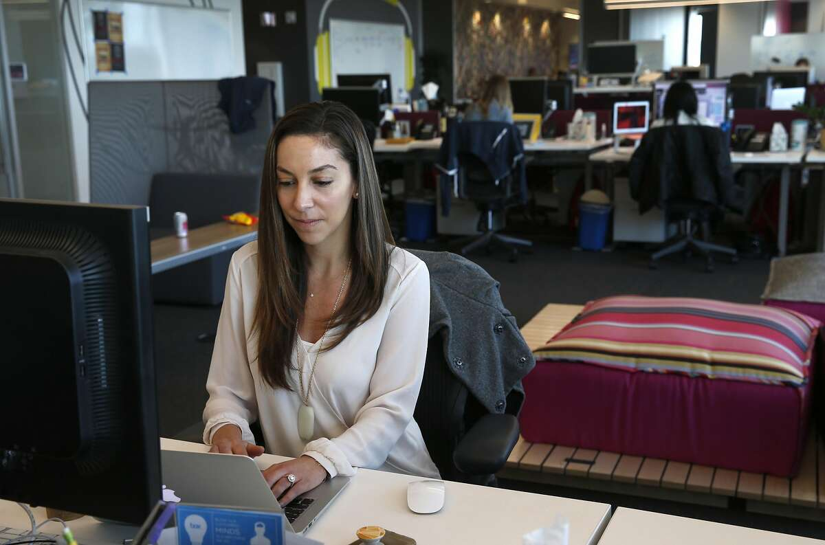 Victoria Makris works at her marketing department job at Box, Inc. after commuting by Caltrain in Redwood City, Calif. on Wednesday, April 19, 2017. Box is one of a few companies that has relocated to more transit-friendly environs and offers free Caltrain transit passes to its employees.