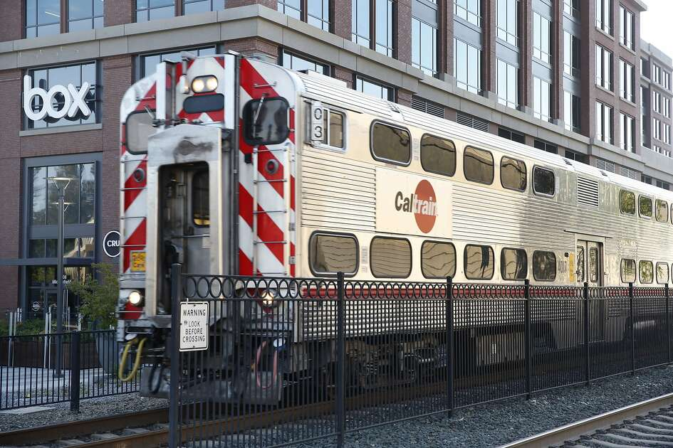 Caltrain arrives at the train station next to the Box, Inc. headquarters office building in Redwood City, Calif. on Wednesday, April 19, 2017. Box is one of a few companies that has relocated to more transit-friendly environs and provides free Caltrain transit passes to its employees.