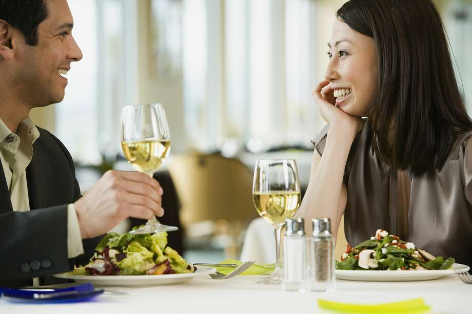 Happy couple eating a meal together Photo: Blend Images - Don Mason/Getty Images