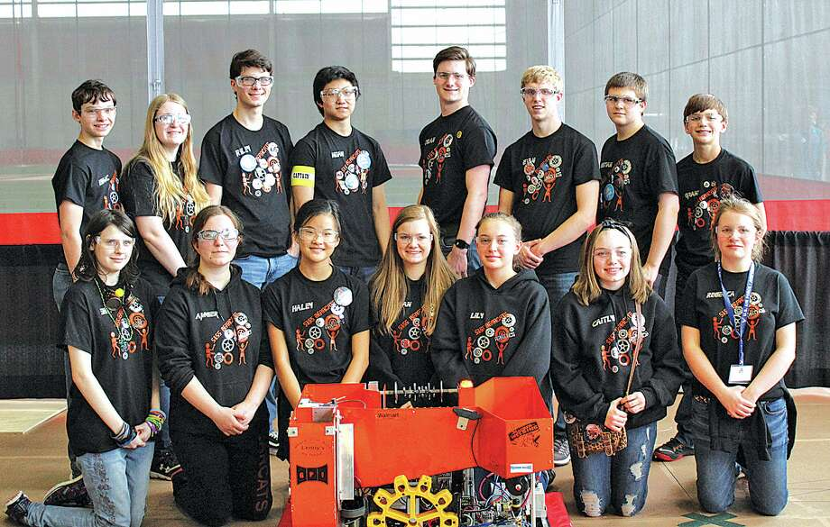 5155 Team members pose with their robot at the Michigan State Finals held at SVSU. Team members are (front row, left to right) Shay Rich, Amber Essenmacher, Haley Krueger, Megan Leppek, Lily Kieliszewski, Caitlyn Maurer and Rebecca Particka. (Back row, left to right) Isaac Booms, Chelsea Holdwick, Riley Murray, Noah Krueger, Dylan Hagen, Evan Franzel, Christian Gezequel and Grant Geiger.