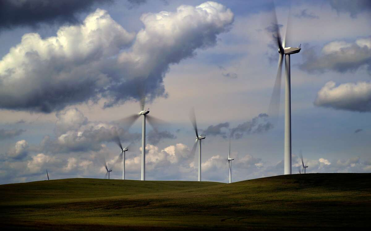 Wind turbines dot the hills outside of Rio Vista, Ca. on Wed. April 19, 2017.
