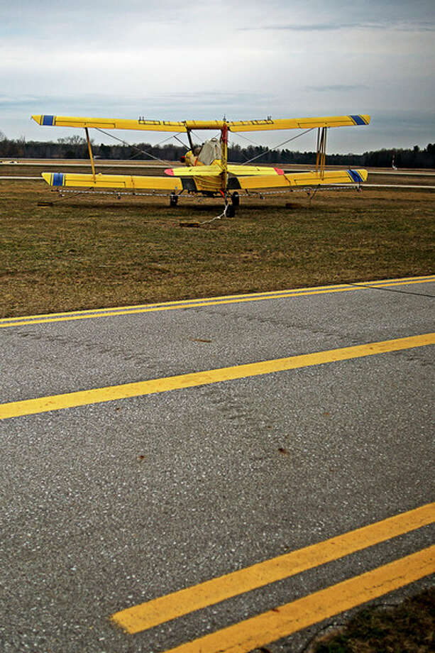 ERIN KIRKLAND | ekirkland@mdn.net A plane waits to be tested for calibration before taking off to distribute mosquito larvicide treatment in this 2016 file photo taken at Jack Barstow Municipal Airport. Mosquito Control planned to treat more than 55,000 acres with larvicide treatment. The planes drop a naturally-occurring bacterium called Bti, which is created through a fermentation process and produces a protein that is only toxic to mosquitoes and related flies. The bacterium, which comes in granule and liquid form, is not toxic to other life forms nor the environment.