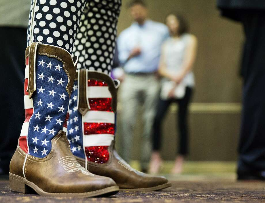 Claire Simpson wears American flag-themed cowboy boots at an election night watch party for Republican candidate for Georgia's Sixth Congressional seat Karen Handel in Roswell, Ga., on April 18, 2017. Photo: David Goldman, Associated Press