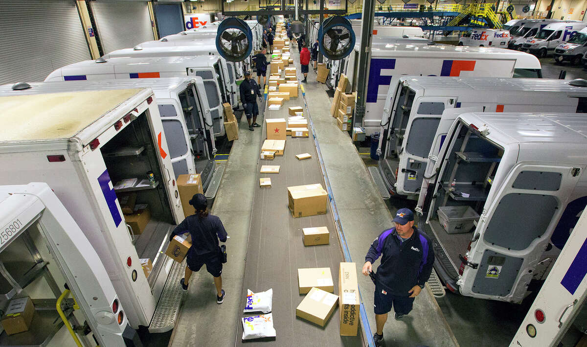 Employees sort packages at the FedEx Ship Center, during Cyber Monday, Monday, Nov. 30, 2015, in Houston. (Cody Duty / Houston Chronicle)