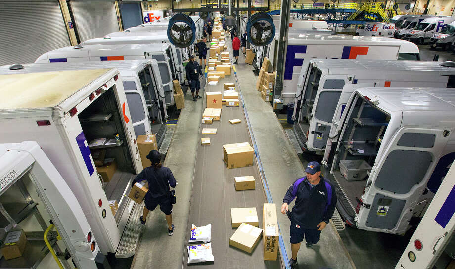 Employees sort packages at the FedEx Ship Center, during Cyber Monday, Monday, Nov. 30, 2015, in Houston. (Cody Duty / Houston Chronicle) Photo: Cody Duty, Staff / © 2015 Houston Chronicle