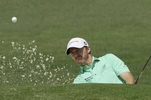 Jimmy Walker hits from a bunker on the second hole during the third round of the Masters on April 8, 2017, in Augusta, Ga.