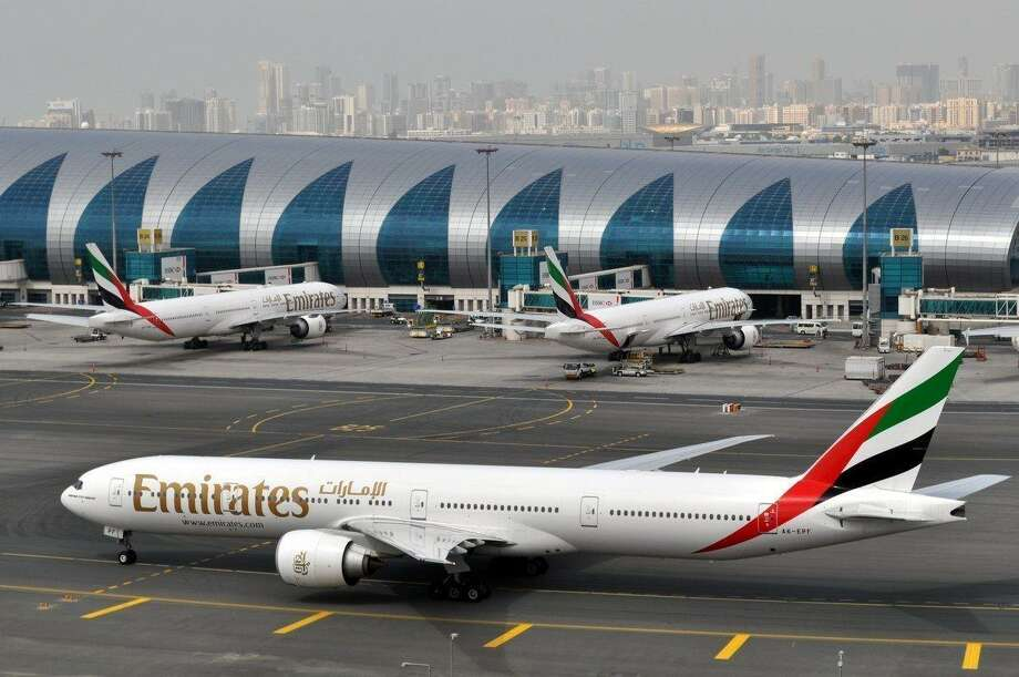 Emirates, the Middle East's biggest airline, says it is reducing flights to the United States because of a drop in demand caused by tougher U.S. security measures and attempts by the Trump administration to ban travelers from a number of Muslim-majority nations. Photo: Adam Scheck /Associated Press / Copyright 2017 The Associated Press. All rights reserved.