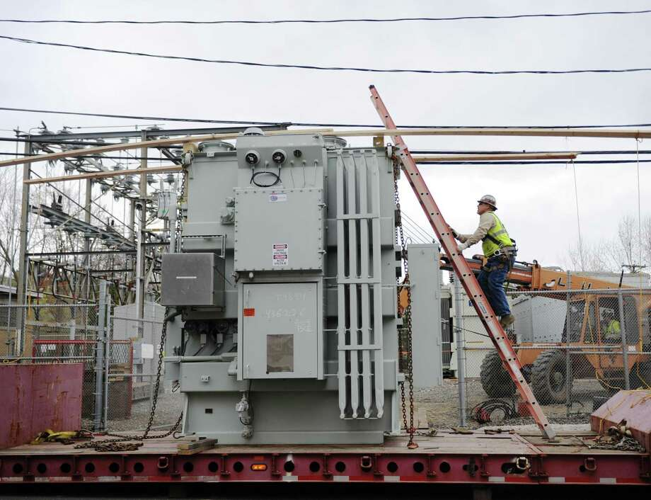 Eversource Energy workers work to replace a transformer at the substation in the Cos Cob section of Greenwich, Conn. Wednesday, April 19, 2017. The transformer was brought in town from Hartford Tuesday and taken off the truck and moved on to the worksite Wednesday. Soon the old transformer will be drained and moved off site and replaced with the new one. Photo: Tyler Sizemore / Hearst Connecticut Media / Greenwich Time
