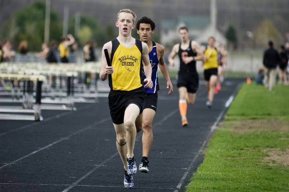 Bullock Creek's Brennan Mudd competes in the 4x800 meter relay on Wednesday at Bullock Creek High School. Photo: Erin Kirkland/Midland Daily News