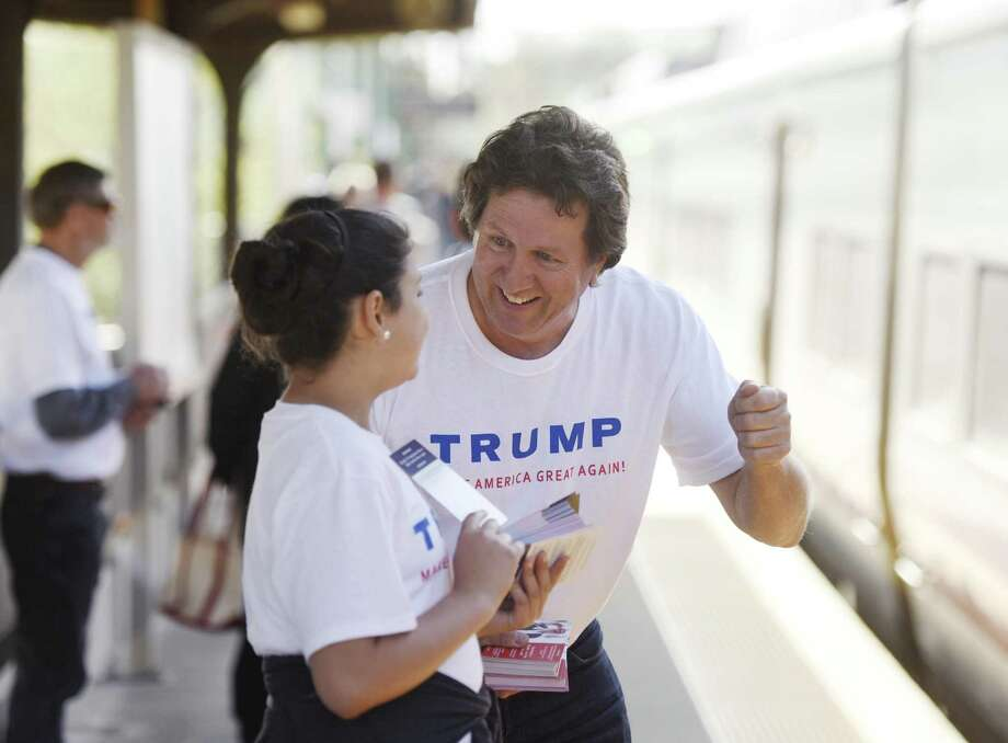 Donald Trump supporter Joe Visconti, a former Connecticut gubernatorial candidate, and his neice Isabelle Blackburn, 11, of Farmington, distribute Trump handouts at the Greenwich Metro-North station in Greenwich in April 21, 2016. Photo: Tyler Sizemore / Hearst Connecticut Media / Greenwich Time
