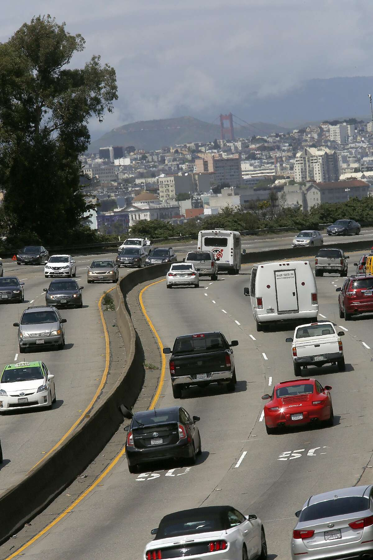 Vehicles seen on highway 101 with lightest traffic during early afternoon on Wednesday, April 19, 2017, in San Francisco, Calif.