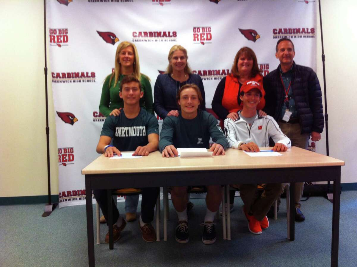 From left to right, Justin Sodokoff, Bailey Savio and Jimmy Catalano each signed National Letters of Intent to play Division I sports during a ceremony at Greenwich High School?'s Media Center. They are each joined by family members. Sodokoff will dive at Dartmouth College, Savio will play lacrosse at Loyola Maryland and Catalano will compete on the crew team at the University of Wisconsin. April 19, 2017.